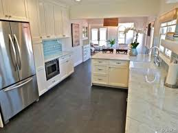 traditional kitchen with breakfast bar subway tile in