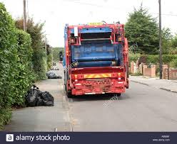 Local Authority Waste Management Garbage Truck On Household Street ...