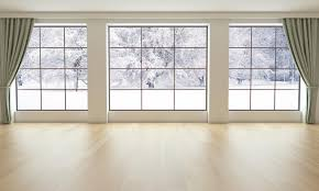 empty living room with snowy landscape perque flooring