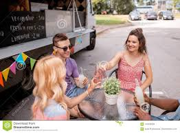 100 Food Truck Road Race Friends Clinking Bottles With Drinks At Stock Photo