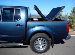 Nissan Frontier Bed Cover by Black Truck Bed Cover On Blue Nissan Frontier A Black Diam U2026 Flickr
