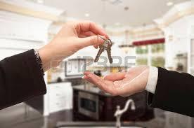 Handing Over New House Keys Inside Beautiful Custom Built Home Stock Photo