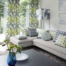 i like the bold print of the curtains and pillows and how neutral