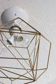 Carefully Reach Inside The Geometric Figurine To Install Your Light Bulbs DIY Pendant Tutorial