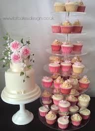 Cupcake Designs Coordinated With Wedding Cake Ivory Pink Ombre Sugar Roses Leaves And Buds Stand Hire Available
