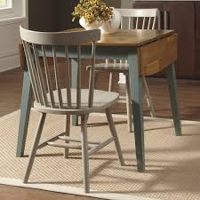 Rug Under Round Kitchen Dining Table Creates Germ Free And Automated Environment Dark Wood Cabinets