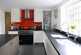 white kitchen red tiles interior design
