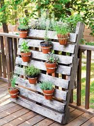 Screw Hardware Store Hose Clamps Onto A Freebie Wood Pallet Add Pots And Herbs Lean It Against Deck Railing For Cool Rustic Arrangement Upcycle
