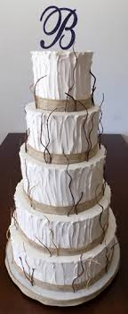 5 Tier Rustic Themed Wedding Cake Decorated With Burlap Ribbons And Twigs