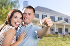 Mixed Race Excited Military Couple In Front Of New Home Showing Off Their House Keys