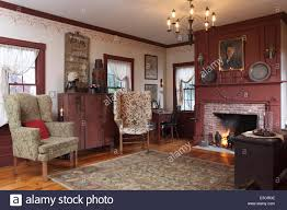 Living Room With Fireplace by A Formal Living Room With Fireplace And Two Wing Chairs White