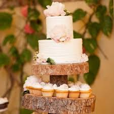 Rustic Wedding Cake With Mini Cupcakes Via Pinterest
