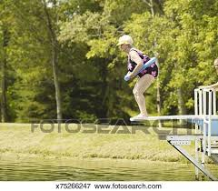 Picture Of Senior Woman Standing On Diving Board Side View