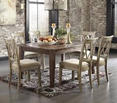 mestler 7 piece table set with antique white chairs by signature