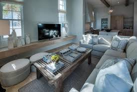 light gray linen plush sectional facing a floating tv stand