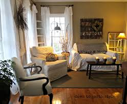 rustic slipcover sofa and chairs in earth tone living room