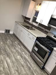 Home Decorators Stony Oak Grey Vinyl Plank Flooring White Shaker Kitchen Cabinets
