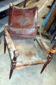 Chairs Prop Hire » Worn Low Leather Chair - Keeley Hire Ancestral Rocking Chair Gio Ebony Antique Rocking Chair Sold The Savoy Flea With Sewing Drawer Collectors Weekly How To Update A Pair Of Wornout Chairs Hgtv A Country Sheraton Youth Sized Thumb Back Rocker 19th Century For Safavieh Alexei Natural Brown Acacia Wood Patio Windsor Kitchen Stripe Caning Seat Weaving Handbook Illustrated Wooden Stock Photos Upholstered Redo Prodigal Pieces