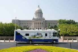 Kentucky Labor Cabinet Secretary by Kentucky Labor Cabinet Kyosh Impact Bus