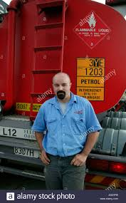 100 Naked Truck Driver Driver Standing Behind His Petrol Tanker Looking At Camera