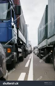 Many Trucks Stopped On European Road Stock Photo (Royalty Free ... Free Racing Trucks Pictures From European Truck Championship American In The Netherlands And Youtube Goodyear Continues As Exclusive Fia Tyre Driverless Truck Convoys Cross Europe Alphr Volvo Entirely Renewed Range Uk Transport Heavy Haulage General Low Pack V11 Modhubus Ats Scania Mod V13 Upd 271117 Mods Platoons Of Autonomous Trucks Took A Road Trip Across Begins Trials Mediumduty Electric