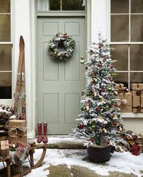 Flocking Powder For Christmas Trees by Interior White Snow Covered Christmas Tree Christmas Tree With