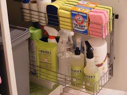 kitchen sink organized cleaning products and recycle trash