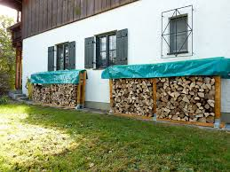 small and narrow side yard spaces with firewood stacked in diy