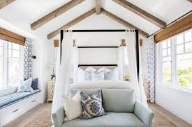 Chic Vaulted Master Bedroom With Wood Beams