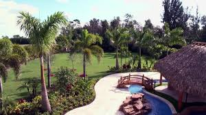Huge Tropical Backyard Oasis Video   DIY Patio Ideas Small Tropical Container Garden Style Pool House Southern Living Backyard Design 1000 About Create A Oasis In Your With Outdoor Plants 1173 Best Etc Images On Pinterest Warm Landscaping 16 Backyard Designs The Cool Amenity For Tropicalbackyard Interior Vacation Landscapes Diy