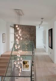 contemporary white wood and glass stair cascade lighting