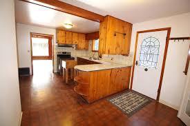 Kitchen Looking Towards Living Room And Entrance Door