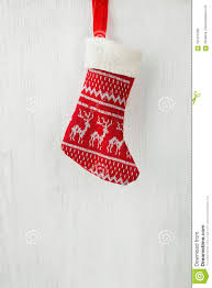 Red Knitted Christmas Stocking Hanging On White Wood Barn Board ... Kiss Keep It Simple Sister Pottery Barninspired Picture Christmas Tree Ornament Sets Vsxfpnwy Invitation Template Rack Ornaments Hd Wallpapers Pop Gold Ribbon Wallpaper Arafen 12 Days Of Christmas Ornaments Pottery Barn Rainforest Islands Ferry Coastal Cheer Barn Au Decor A With All The Clearance Best Interior Design From The Heart Art Diy Free Silhouette File Pinafores Catalogs