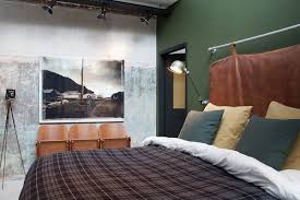 Industrial Bedroom With A Cool Headboard And Green Wall