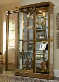 Pulaski Glass Panel Display Cabinet by Two Way Sliding Door Curio Cabinet In Estate Oak By Pulaski Home
