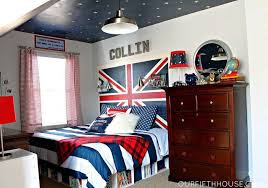 wars themed boy bedroom with wood dresser and