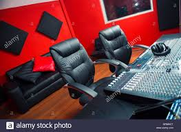 Classy Professional Recording Studio Setup Large Desk With Mixing Console And Two Chairs Window