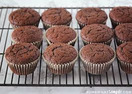 Fluffy Baked Chocolate Cupcakes Sitting On A Cooling Rack Made With This Homemade Hostess Recipe