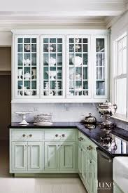 A Coat Of High Gloss Oil Benjamin Moore Paint In Turquoise Mist Color Inspired By The Paris Tea Salon Laduree Transformed Kitchen Cabinetry