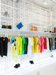 Sumit Shop By Design Seoul Lets The Clothes Do Talking With Simple But Unique White Brick Walls And Pipe Displays Clothing Accessories Make