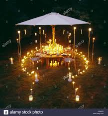 Candlelight Garden Party Large Round Wood Dining Table Four Chairs ... Standard Fniture Rossmore 7 Piece Rectangular Ding Set Dunk Maison Ranges Room Just Imagine The Beautiful Dinner Parties You Could Throw With This China White Nordic Event Party Table Tms Lucca 5 Multiple Colors Walmartcom 50 Outdoor Ideas You Should Try Out This Summer Tables And Chairs For Sale Wooden Buy Aspenhome New Year Christmas Style Chair Cover Decoration 2017 Bay Isle Home Solange Reviews Wayfair 5pcs Metal 4 Breakfast Black Dinner Mistana Thomasson
