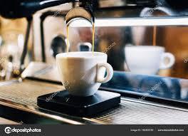 Espresso Machine Pouring Coffee Into White Cup Stock Photo