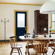 Inspiration For A Farmhouse Light Wood Floor Dining Room Remodel In New York With White Walls