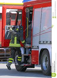 100 Action Truck Firefighter In Jump Down Quickly From The Fire Stock