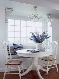 Breakfast Nook With A Window Seat And Round Table