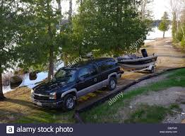 100 Truck Boat A Pickup Truck With A Trailer And Fishing Boat With Motor Attached