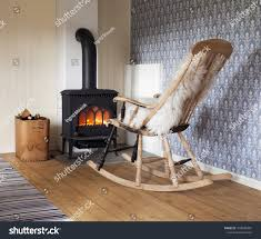 Scandinavian Interior Wood Burning Stove Box Stock Photo ... Somerville House In Winter Hill Includes Rockingchair Comfy And Lovely Rocking Chair Plans Royals Courage Gorgeous Living Room Ideas Appealing Decorating The Monster Corner Because It Really Is Personal Stthomas Drawing By Lacey Cooling Iconic Style Of The Mainstays Chairs For Small Spaces Baby Nursing Wooden At Near Window With Sunlight Stock White Wooden Rocking Chair For Nursery Living Room Garden 20 Wandsworth Ldon Gumtree Placed A Corner Photo House Red Chairspeed Plow Sofar Inverness
