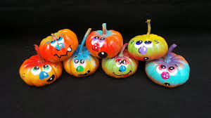 Cute Carved Pumpkins Faces by Painted Pumpkins