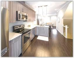 white kitchen cabinets light wood floor home design ideas