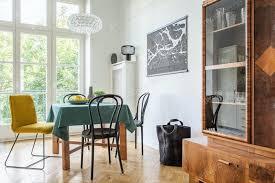 retro esszimmer interieur mit einem tisch stühlen und schrank in foto bialasiewicz auf envato elements